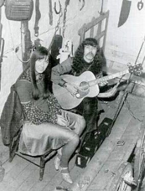 Pat Drinkwater with guitar and woman